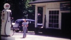3020 filling the gas tank at local station - vintage film home movie Stock Footage