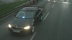 Portugues police car with policeman and blue flashing lights chasing car Stock Footage