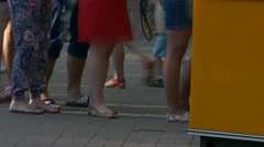 Ungraded: Legs of People Standing in Line at Box Office on Street in The Stock Footage