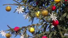 Decorated Christmas tree on background blue sky - stock footage