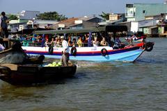 Tourists visit the floating market - stock photo