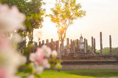 Buddha sculpture and temple ruins in Sukhothai historical park, Thailand Stock Photos