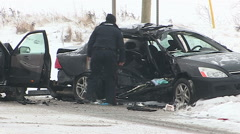 Fatal car accident and crash in snowstorm on icy road Stock Footage