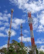Communications tower with beautiful blue sky - stock photo