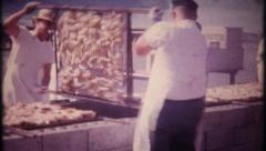 3023 chefs barbecue chicken meat on large grill - vintage film home movie Stock Footage