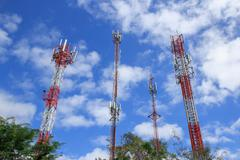 Communications tower with beautiful blue sky Stock Photos