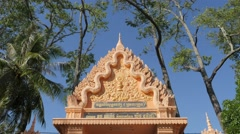 Entrance gate to temple with wind in trees,Kratie,Cambodia Stock Footage