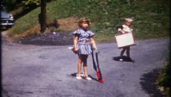 3028 on the road, girl has gun, boy has suitcase - vintage film home movie Stock Footage