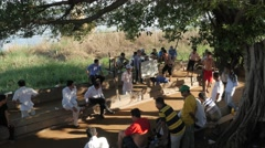 Men playing petanque game under tree,Kampong Cham,Cambodia Stock Footage