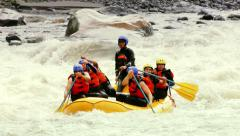 Group Of Six Young People Whitewater Rafting - stock footage