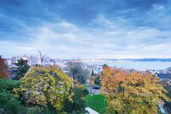 Skyline and landscape of cityscape and nature around lake Stock Photos