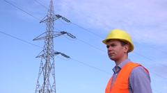 Engineer on electrical field on break, drinking water and looking around, 4K Stock Footage