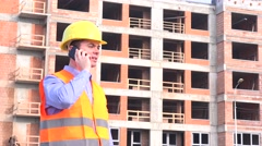 Stock Video Footage of Foreman on construction site talking to real estate developer, presenting status
