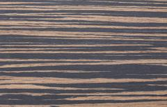 brown zebrano wood texture for backgrounds and overlays - stock photo