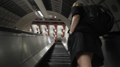Woman Rides Up Subway Escalator - stock footage