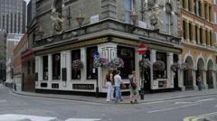 People Walk London Streets Near Pub Stock Footage