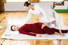 Woman getting thai stretching massage Stock Photos