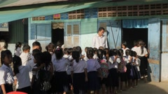 Schoolkids line up to go in school,Poipet,Cambodia Stock Footage