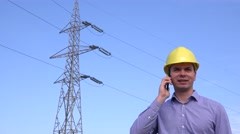 Supervisor in electricity sector planning electrical field check on mobile phone Stock Footage