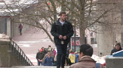 Students walking to class on campus with light snow flurries Stock Footage