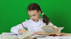 Emotional little girl tears spoiled paper. Child doing homework - stock footage