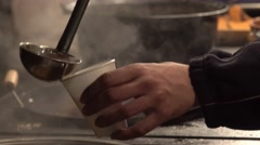 Pouring mulled wine into plastic cup 4K Stock Footage