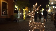 Lighting deer decoration in a christmas fair 4K Stock Footage