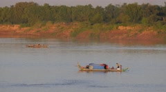 Stock Video Footage of Fisherman family on boat in Mekong river,Kampong Cham,Cambodia