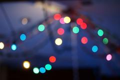 Blur colorful christmas lights bokeh background - stock photo