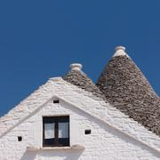Trulli of Alberobello detail of typical conical roofs - stock photo