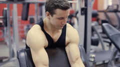 Man working arms  gym, lifting bells, Stock Footage