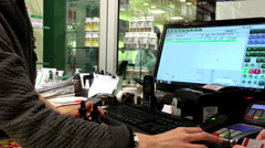 Close up woman tapping credit card at payment terminal Stock Footage