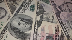 Russian money coins  falling down on USA dollar. Stock Footage