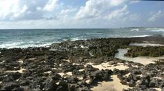 Twin blow holes spout ocean spray in jagged rock on east shore Cozumel - stock footage