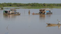 A boat and 2 floating houses on Tonle Sap lake,Phnom Krom,Cambodia Stock Footage