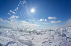 Ice floe and sun on winter Baikal lake Stock Photos