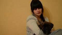 Young brunette hugging a dog. Close-up - stock footage