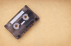 cassette on vintage paper - stock photo