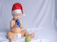 Little baby in Santa hat on white background Stock Footage
