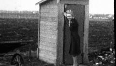 Woman Uses Outhouse Outdoor Toilet WC Rural 1930s Vintage Film Home Movie 8868 Stock Footage
