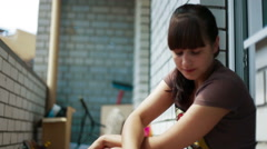 Young brunette smoking on the balcony. Close-up - stock footage