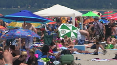 Scorching hot summer beach scenes on sand and water at Wasaga beach Canada - stock footage