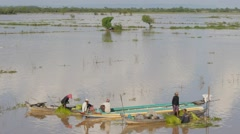 People cutting vegetable on boat on Tonle Sap lake,Phnom Krom,Cambodia Stock Footage