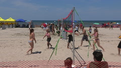 Scorching hot summer beach scenes on sand and water at Wasaga beach Canada Stock Footage