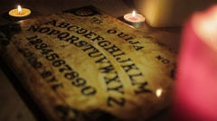 Ouija Board with Candles pull focus Stock Footage