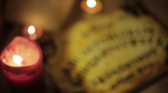 Top down shot of Ouija Board with Candles Stock Footage