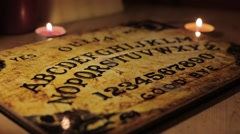 Ouija board with candles Stock Footage