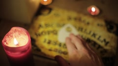 White Male using Ouija Board out of focus topshot Stock Footage