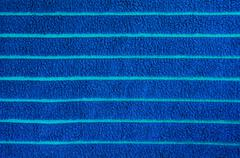 Blue beach towel texture and background - stock photo