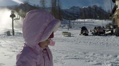 Small child walking with his mother in the mountains on a sunny day in winter Stock Footage